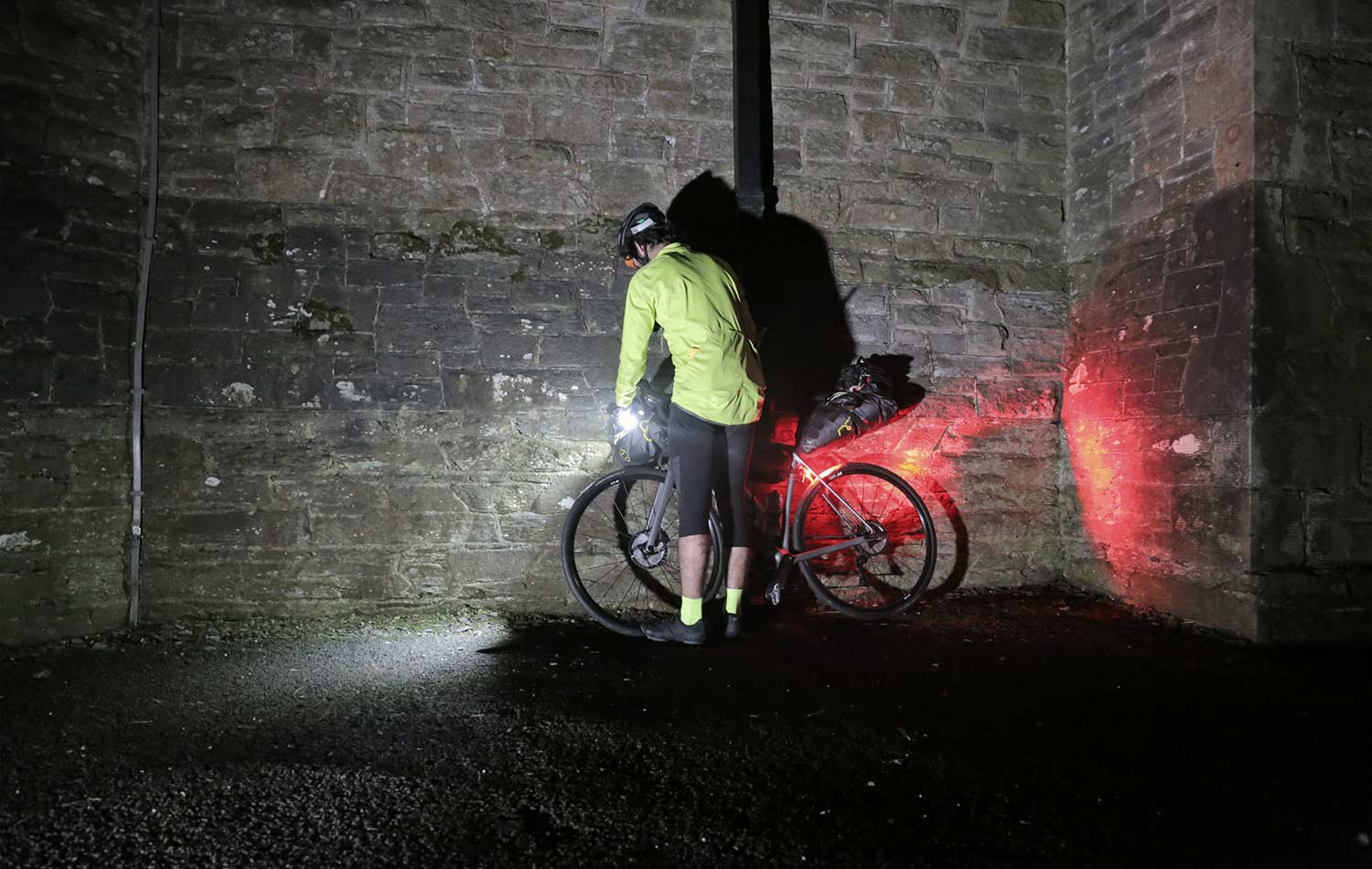 Tomy-Mulledy-Garcia-fixing-his-bike-lights-by-night-before-the-TransAtlantic-Way
